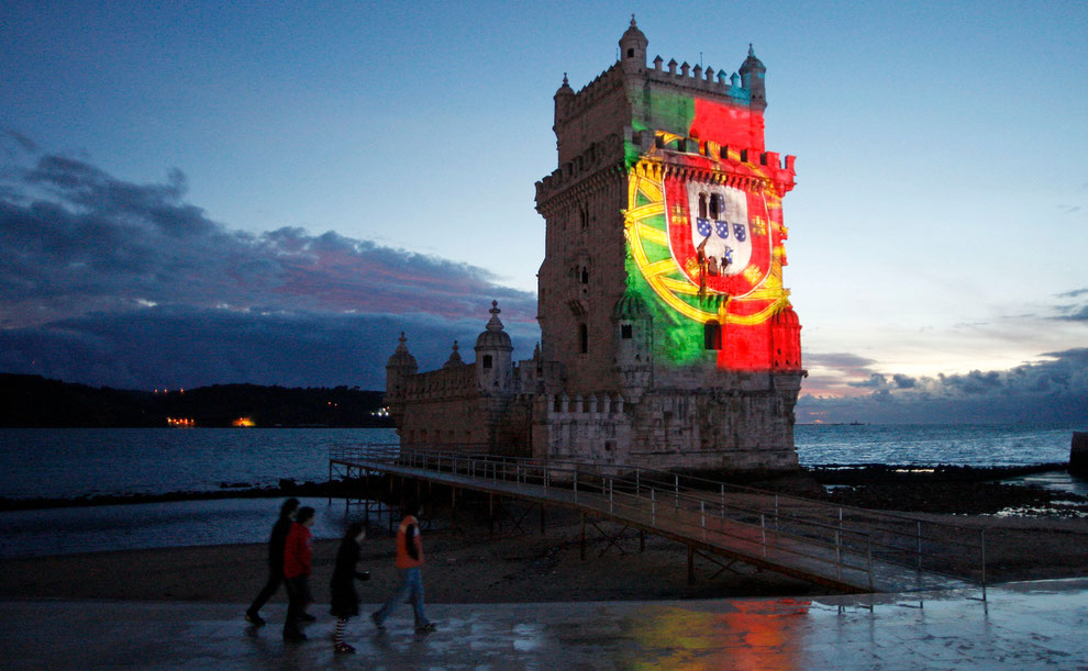 Belem tower with portuguese flag projected over in November 2009
