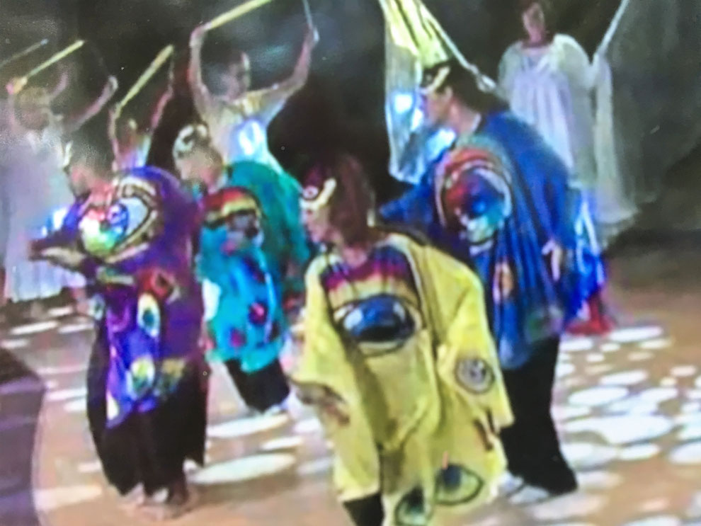 Dancers in costumes representing the Four Living Creatures in the Bible