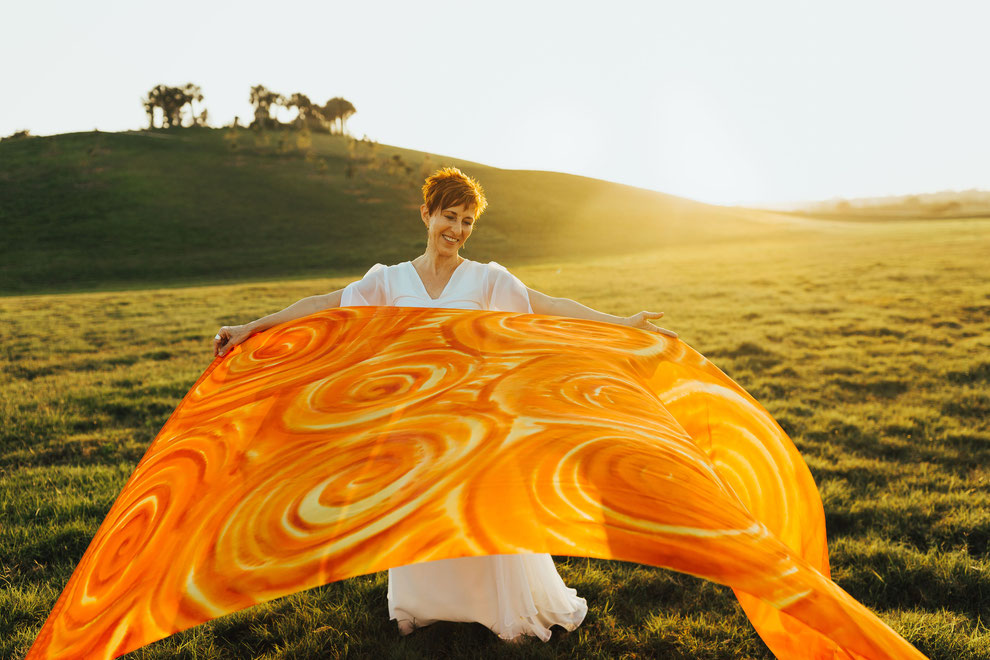 Swirls of hot orange and yellow on a silk flag