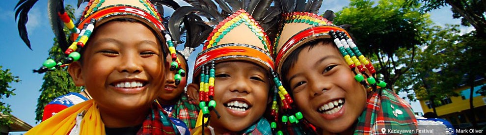 Filipino kids show off their winningest smiles at the Kadayawan Festival. (photo by Mark Oliver from itsmorefuninthephilippines.com)