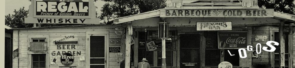 Man sieht ein altes Geschäft mit sehr vielen Logos wie beispielsweise Coca Cola an der Aussenfassade. Auf dem Bild steht Logos. Unter dem Bild werden Logogestaltungen von Alexander Kurzhöfer gezeigt.