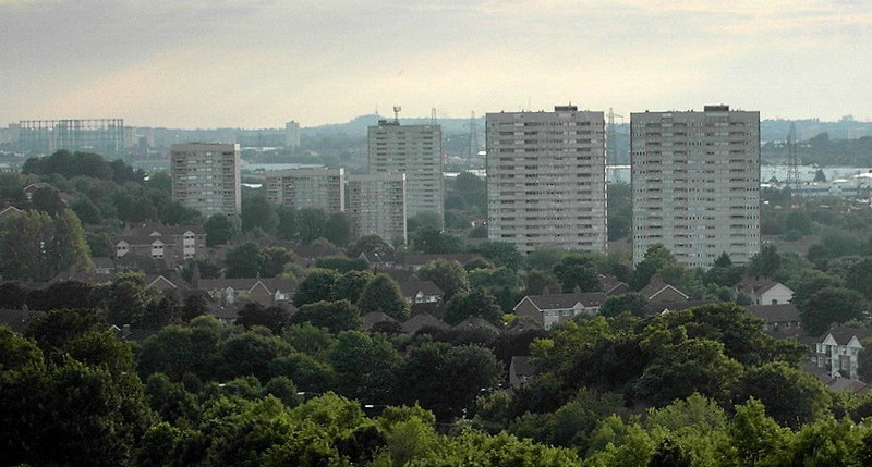 Blocks of flats on Bromford ; low-rise houses among the trees in the foreground are on the Firs estate. In the distance the Dudley hills.