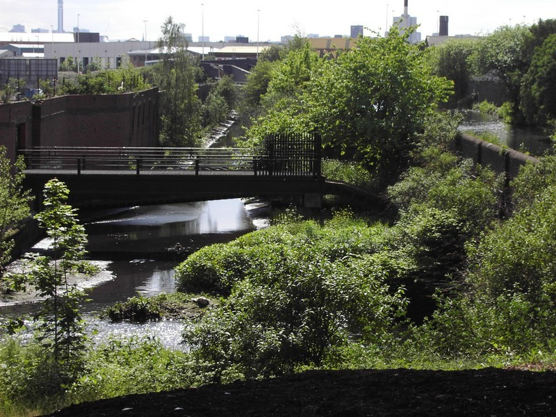 Near Salford Bridge, the confluence of Aston (Hockley) Brook just before its confluence with the Tame. On the right is the Birmingham & Warwick Junction (Grand Union) Canal)