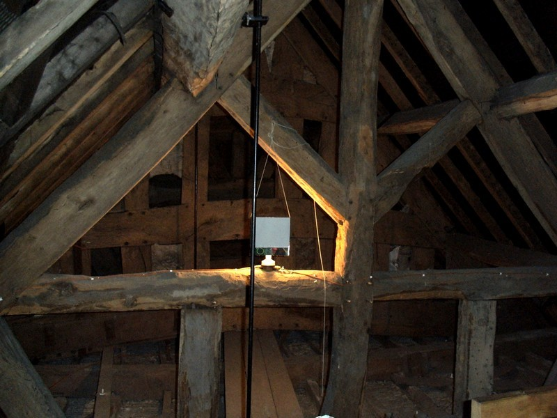 The near timbers in the roof space are 18th-century. The far timbers are those of the end wall of the medieval church.