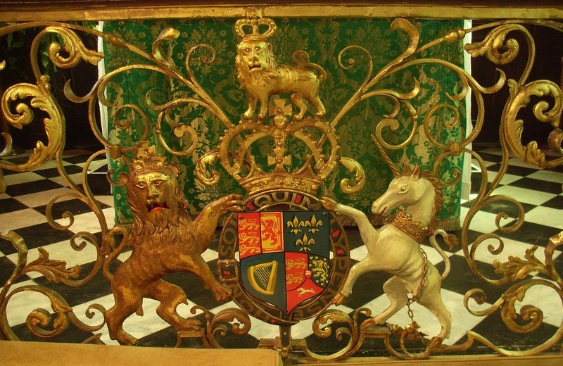 The excellent wrought-iron altar rail of 1743 and that of the chapel at the Bridgeman family seat at Weston-under-Lizard are the only ones in the country to show the royal arms of George II in this position.