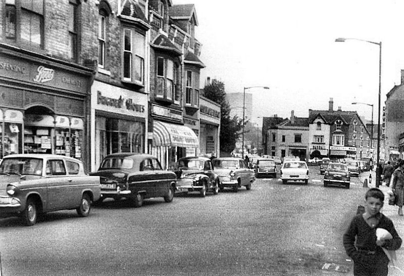 Erdington High Street, looking towards the Green. The boy is returning from the swimming baths in Mason Road at the top right of the picture. Reproduced with the permission of Keith Berry from his on-line collection - see Acknowledgements.