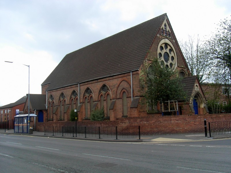 Selly Park Baptist Church on the Pershore Road. The buildings at the back of it are those of Selly Park Girls' School.