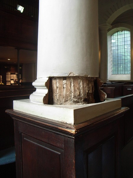 18th-century plasterwork removed to reveal medieval oak pillars.