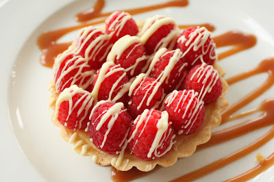 Raspberry Tartlet with White Chocolate Drizzle