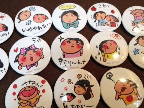 can badges with the portrait of children
