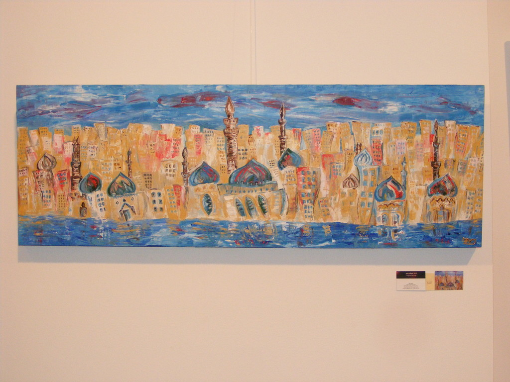 "City of Minarets II, 50"" x 20"". Inspired by Cairo, and the feelings the city evokes in me.  I was trying to provide a sense of the movement, colour and life in a city...rather than the lifeless, stationary structures. No longer available."