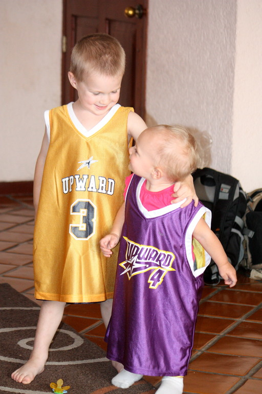 The girls brought down some small old jerseys and passed them on too the kids.