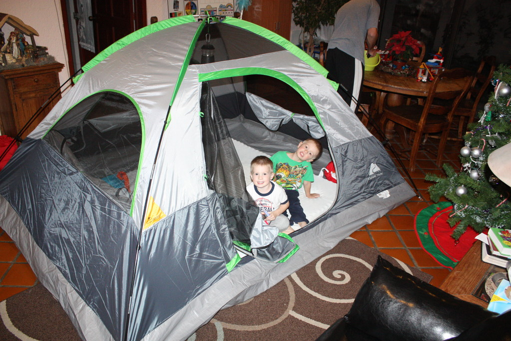 This was our family gift... we set this up Christmas night, turned out the lights and told stories and played chutes & Ladders like we were camping. It was so much fun! THe boys had their flashlights we got them for Christmas and glow sticks.