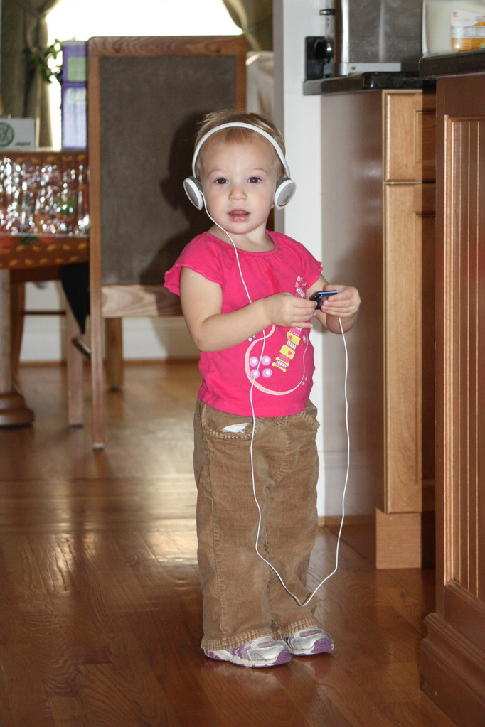 This girl LOVES music. She's stealing grandma's headphones.