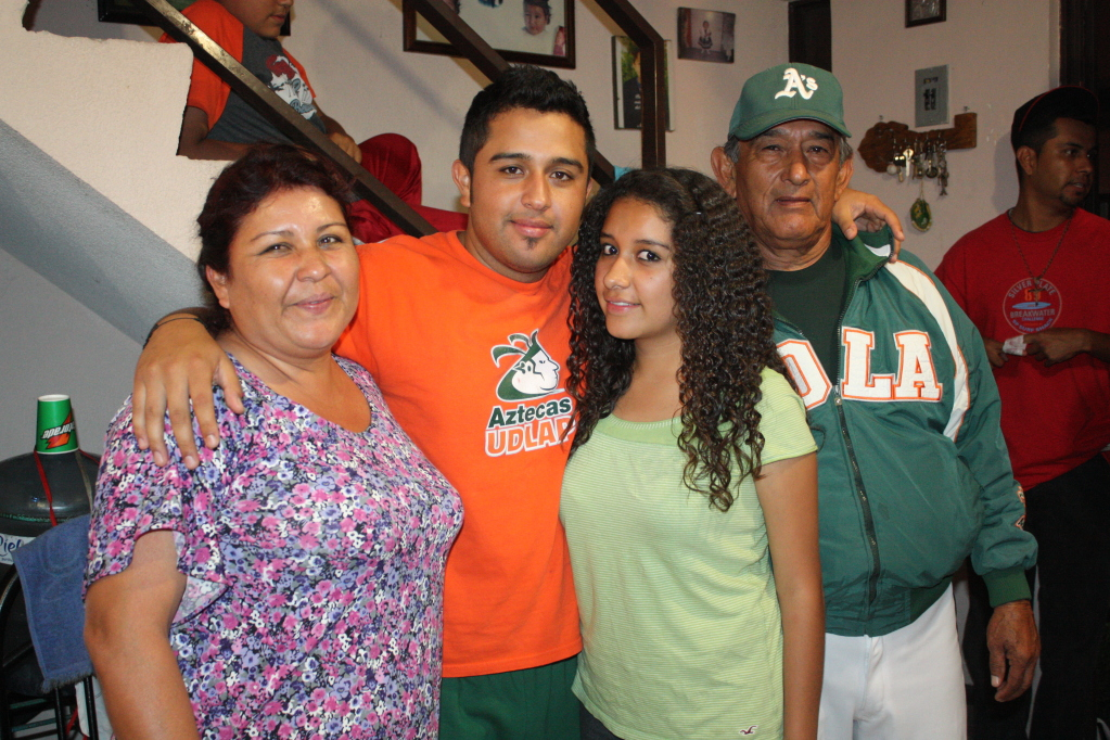 Julio with his little sister and his parents.