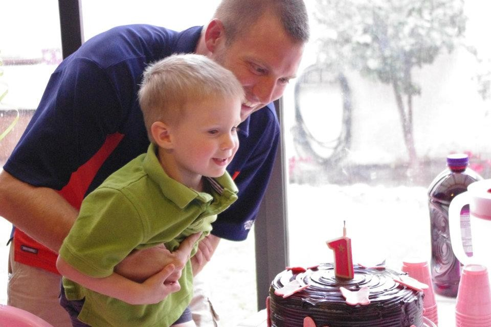 Hudson helped his little sister blow out the candles.