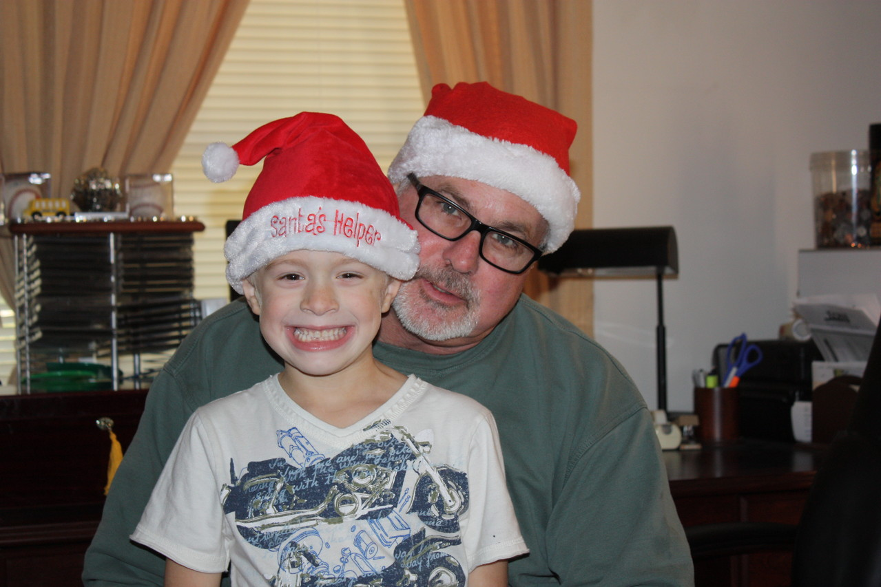 We celebrated Christmas with my family too... Guess who got to play Santa with Papa