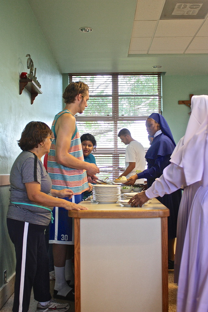Jake, one of our players being bold and serving the nuns breakfast.