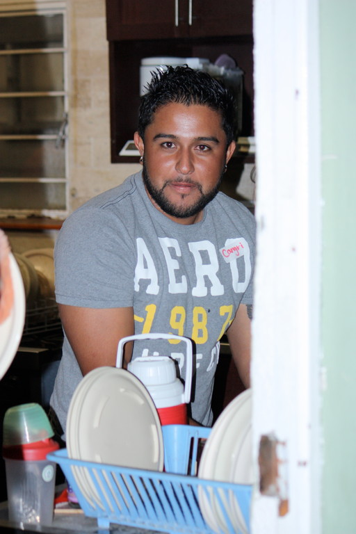 After one of the outreach events, Julio helped clean all the dishes at Casa Verde