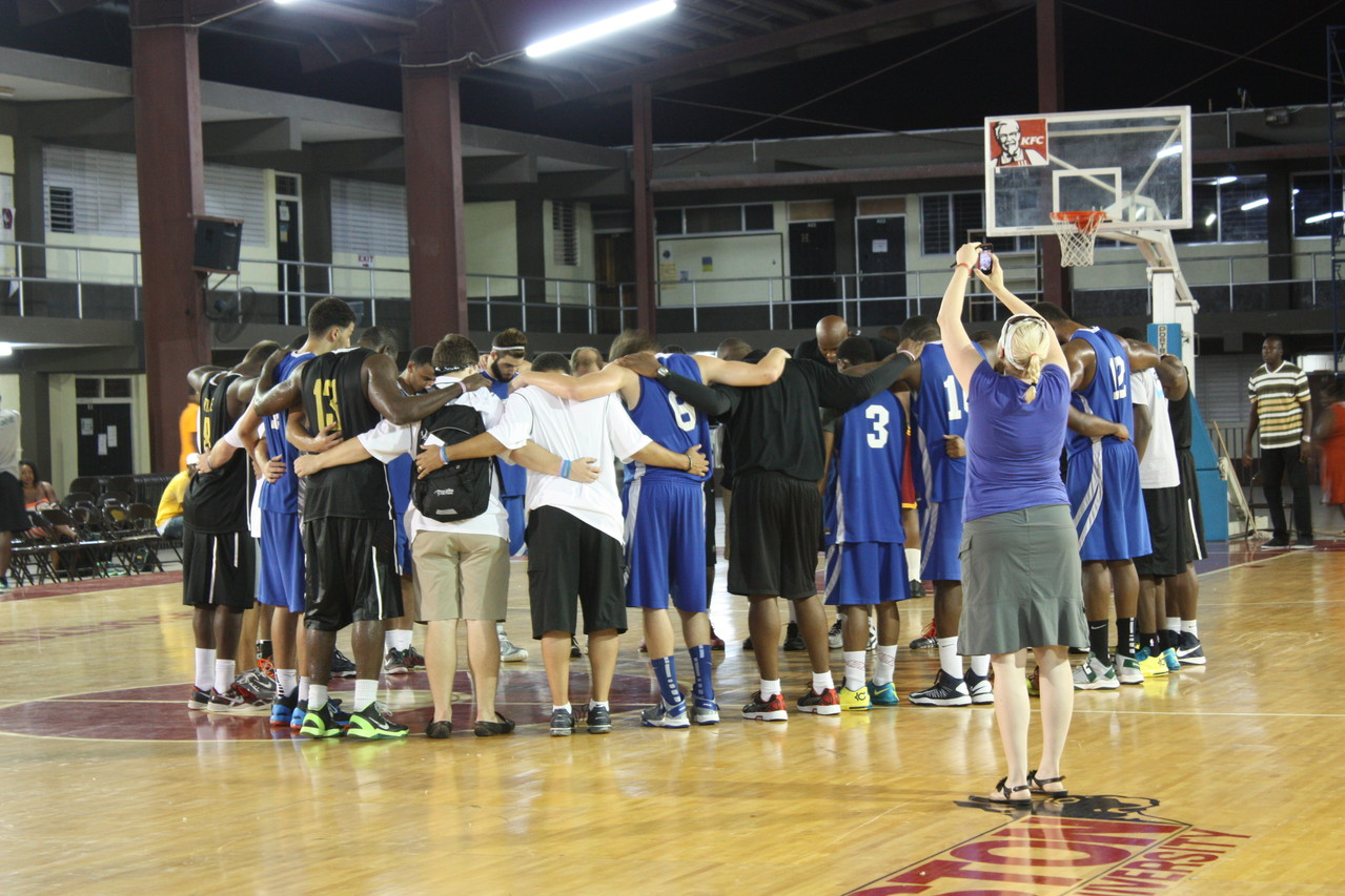 Praying with one of the other teams.