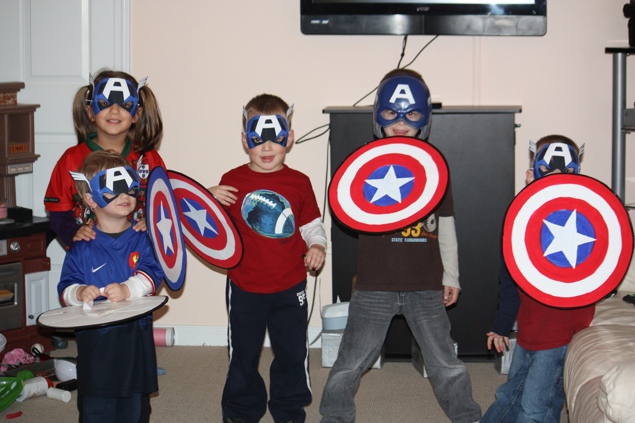 Next was Captain America. I printed the masks from a disney sight and made the shields with white cardboard and paint. I used duck tape to make the handles on the backside.