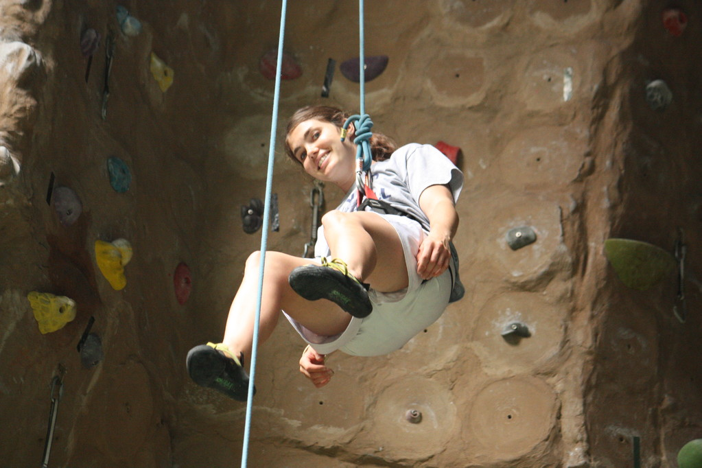 Katie rock climbing.