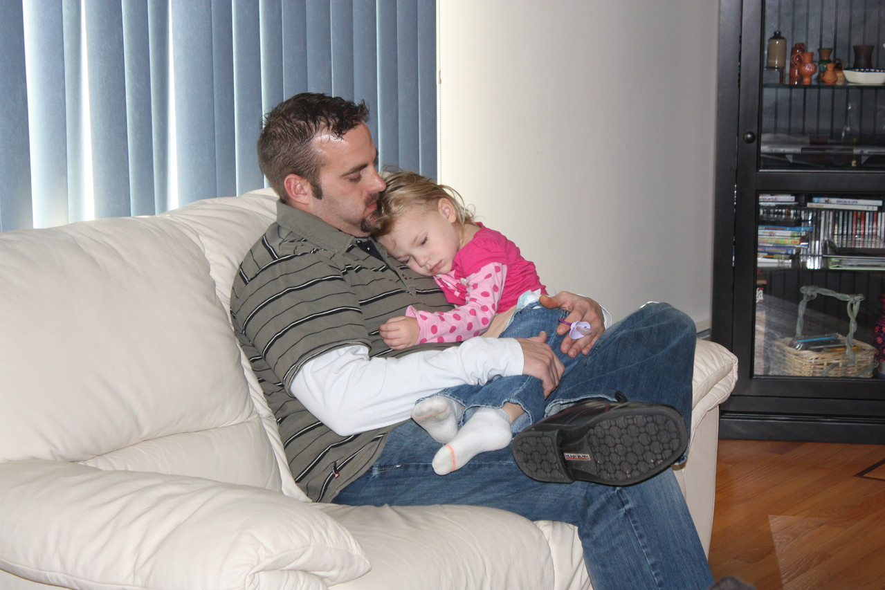 A long day = a nap on uncle Justin's lap