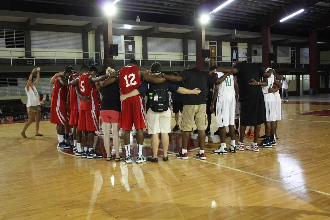 Praying with the national team.