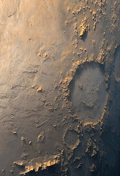 Noch ein weiterer Smiley auf dem Mars... fehlt nur noch einer, der die Zunge rausstreckt :-P   Aufgenommen am 03.10.1999 von Mars Global Surveyor (NASA)