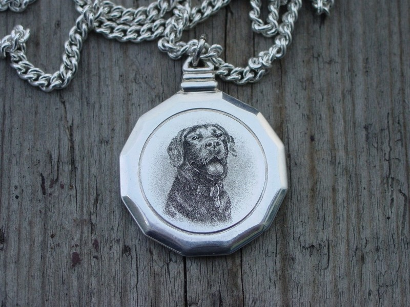 Silver pendant with dog engraving