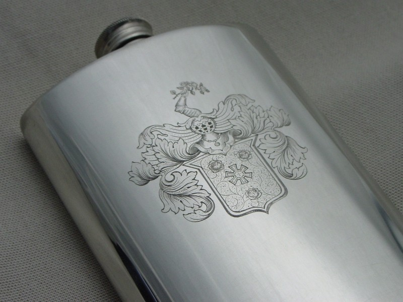 Pocket bottle of tin, engraved with family escutcheon
