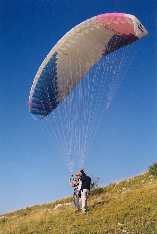 Paragliders and hang-gliders take off from the Buc mountain