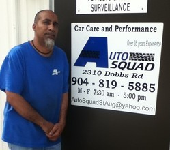 Auto Squad owner, Phillip Johnson stands in front of his auto repair facility in St. Augustine, Florida.