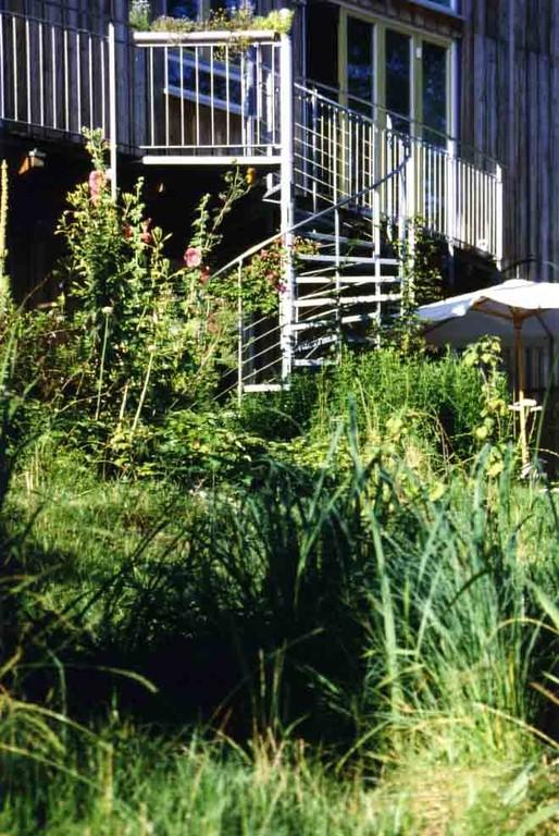 Wohnen im OG mit guter Aussicht und Verbindung zum Garten