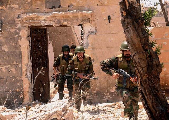 Assad tropper i byen Deraa