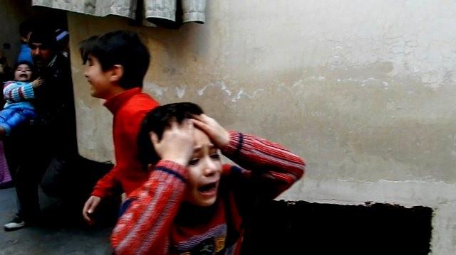 Bomberegn over  Bab Tudmor - kvarteret i Homs
