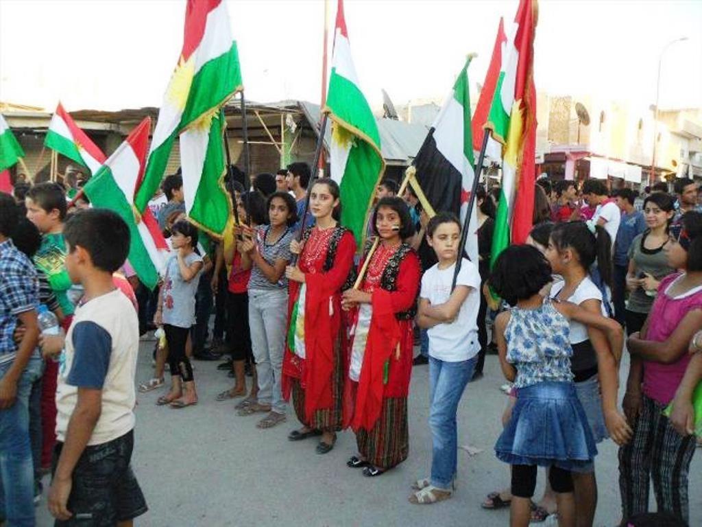 Børnene deltager i Newroz-festen i Kobani