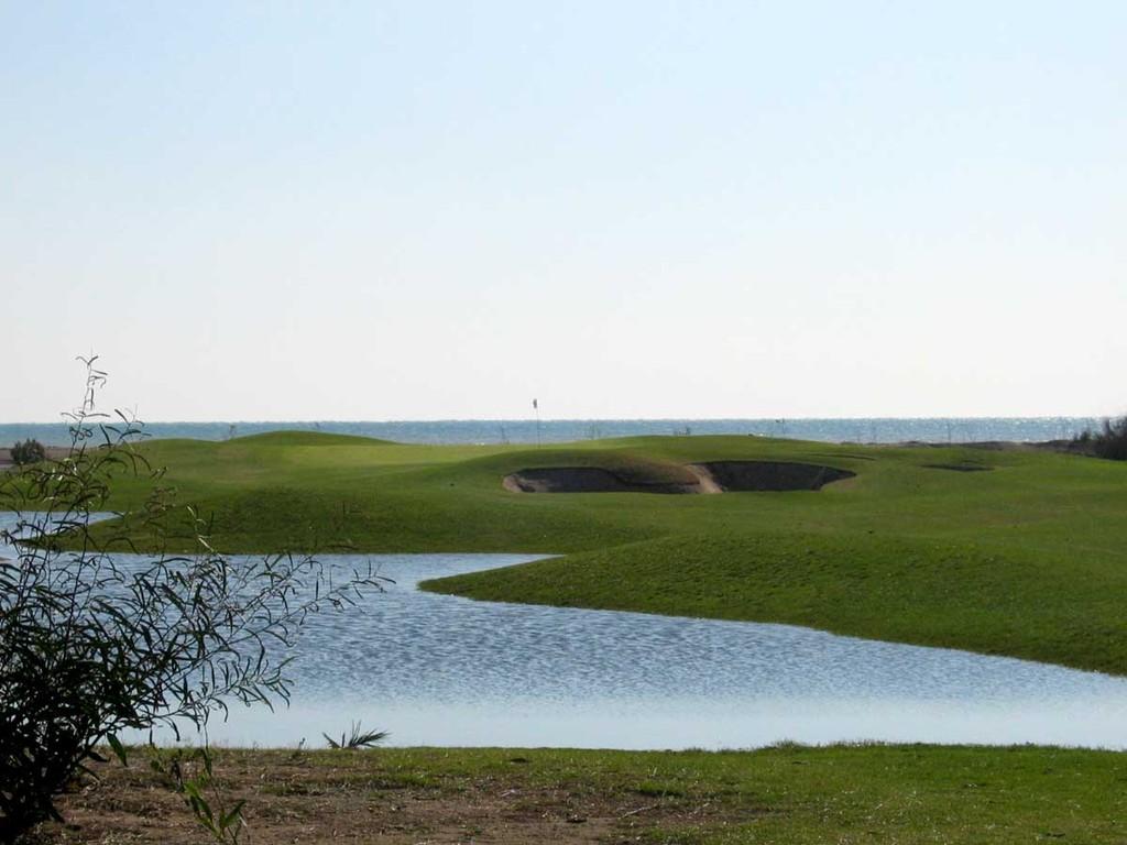 Tat-Golf Grün 19 mit Meer und zeitweiligem Wasser