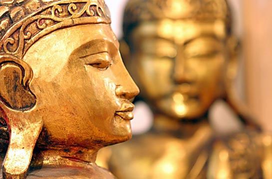 Vergoldete Buddhas aus Holz