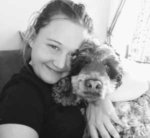 pet sitting service in your home by Sophie owner of K9 seen her cuddling a gorgeous springer spaniel takes care of your pets in your own home, member of Wheathampstead businesses Group