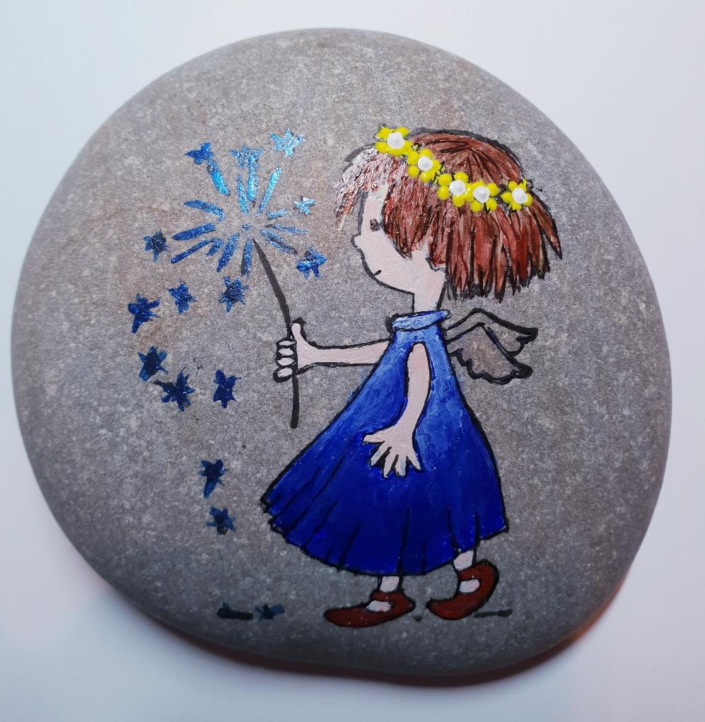 Eine kleine blaue Elfe die beim Wünsche erfüllen hilft.