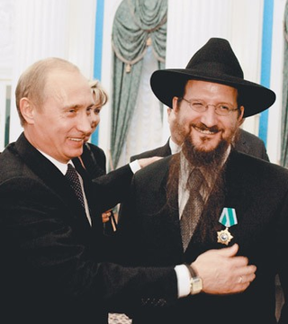 Putin und Berel Lazar (Quelle: http://redefininggod.com/2016/02/chabad-lubavitch-vladimir-putin-and-the-globalist-end-times-script/)