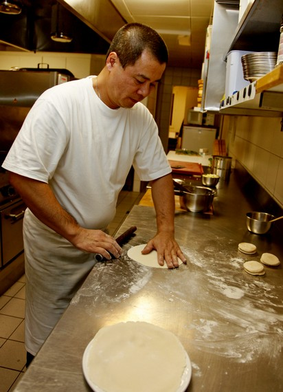 Roll the dough with a stick to a thin round sheet