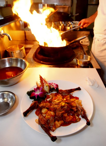 The meat of duck is panfried with other ingredients in a wok and served as main course