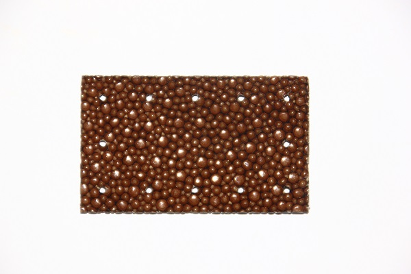 Découpe laser d'un rectangle de galuchat de 5 cm  x 3 cm . 12 trous diamètre 1 mm