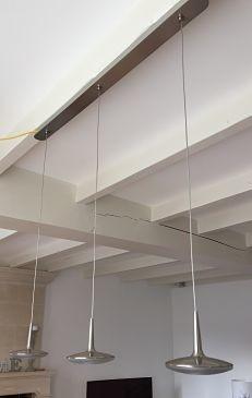 Luminaire : Cette suspension trouvera sa place au dessus d'une table pour un rendu original.