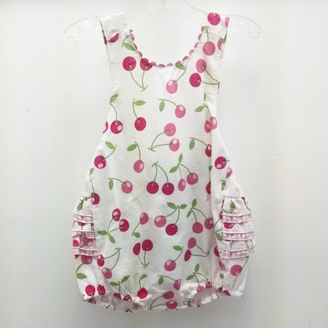 Cherry Romper with ruffled back