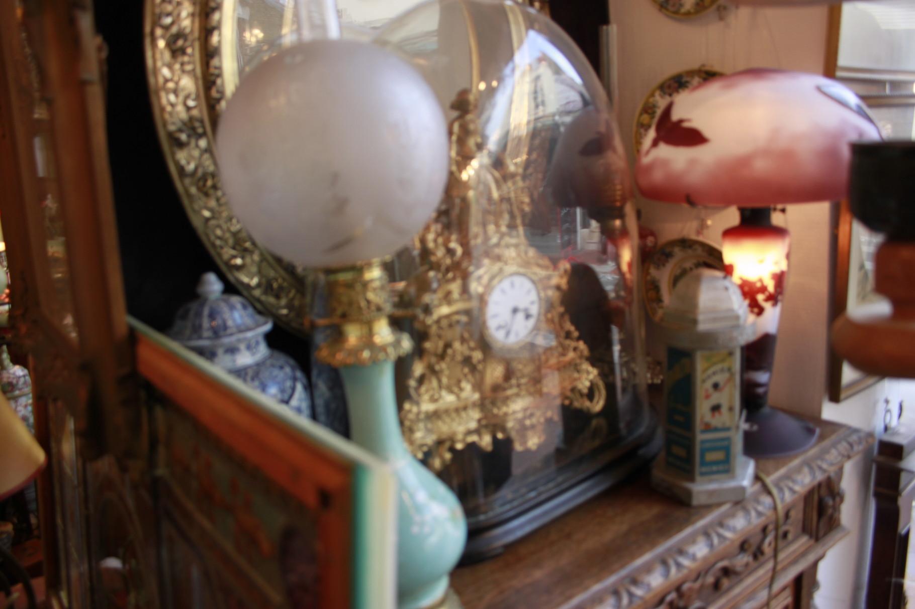 pendule bronze lampe a petrole