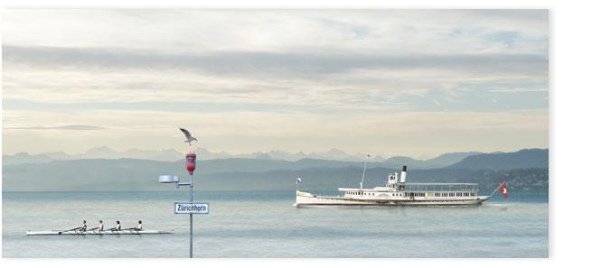 Seeschiff Stadt Zürich und Ruderboot auf dem Zürisee beim Zürihorn