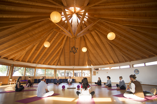 yoga class in spacious wooden yoga shala at monthe velho with lets yoga